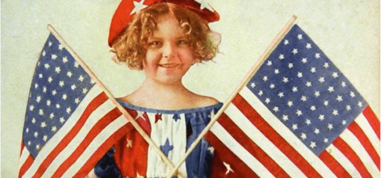 curly haired child holding two American flags